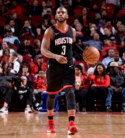 HOUSTON, TX - DECEMBER 13: Chris Paul #3 of the Houston Rockets handles the ball against the Charlotte Hornets on December 13, 2017 at the Toyota Center in Houston, Texas. NOTE TO USER: User expressly acknowledges and agrees that, by downloading and or using this photograph, User is consenting to the terms and conditions of the Getty Images License Agreement. Mandatory Copyright Notice: Copyright 2017 NBAE (Photo by Bill Baptist/NBAE via Getty Images)