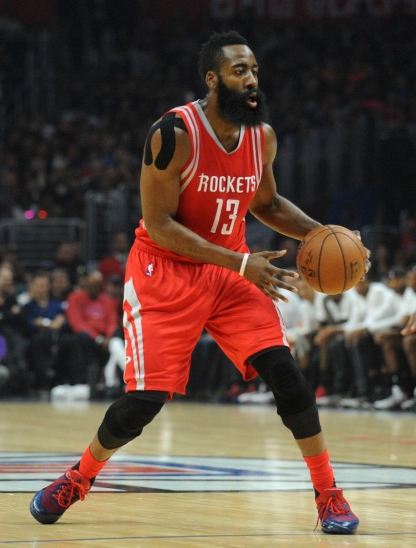 November 7, 2015; Los Angeles, CA, USA; Houston Rockets guard James Harden (13) controls the ball against Los Angeles Clippers center DeAndre Jordan (6) during the first half at Staples Center. Mandatory Credit: Gary A. Vasquez-USA TODAY Sports