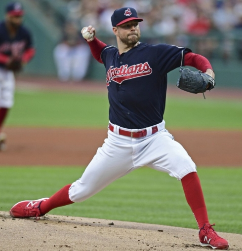 Cleveland Indians starting pitcher Corey Kluber delivers in the first inning against the New York Yankees, Thursday, in Cleveland. (AP Photo/David Dermer)